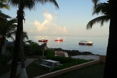 photo of dive boats at sunset house